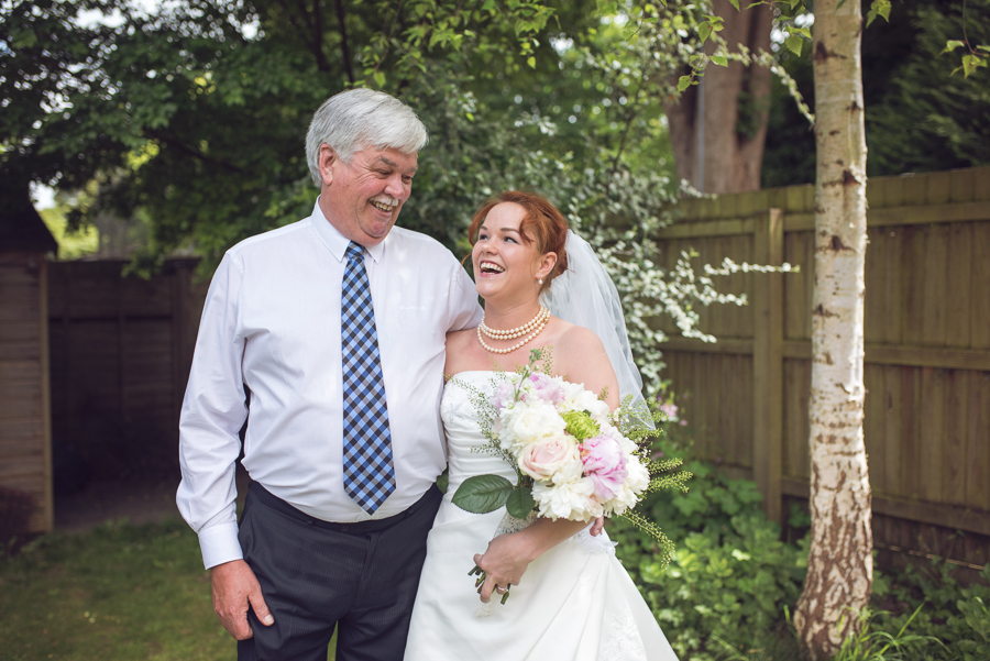 Bride with her dad before wedding