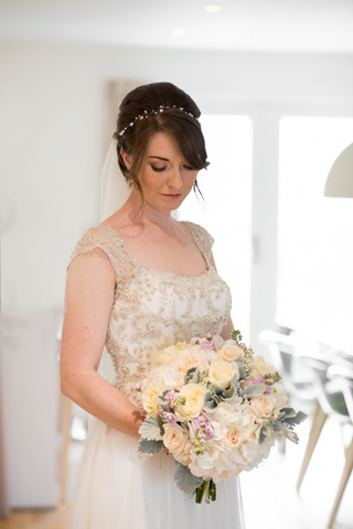 Bride in her dress with her flowers