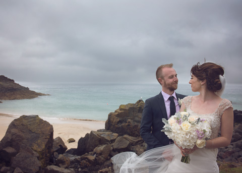 Bride and groom on beach porthgwidden in St Ives