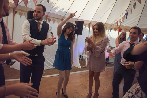 Guests dancing in a marque in st ives