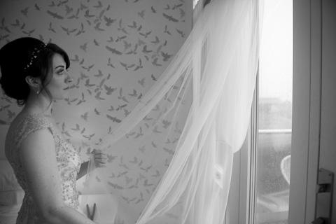 Bride looking at her veil