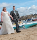 Married couple walking on st ives harbour