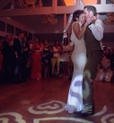 Bride and groom first dance in a barn wedding