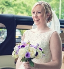 Bride smiling with her bouquet