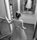Bridesmaid looking in a mirror