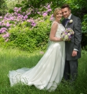 Bride and groom in the woods on their wedding day