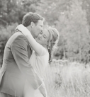 Bride and groom hugging at their country style wedding
