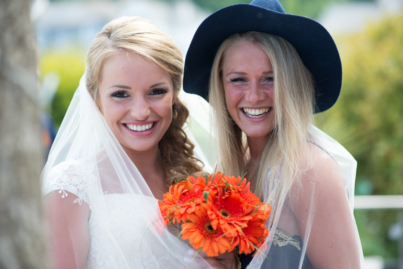 Bride and bridesmaid laughing at the Harbour hotel St ives wedding
