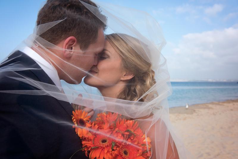 Couple kissing on Porthminster beach, stives, cornwall