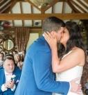 Barn wedding, bride and groom first kiss