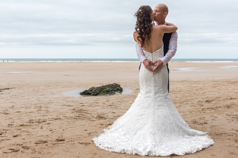 Bride and groom on a beach at their bedruthan, newquay wedding