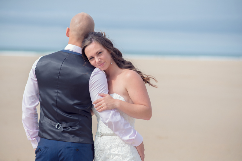 Couple on a beach at bedruthan, newquay wedding
