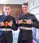 Groom and best man wearing marvel under their army uniform