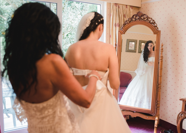Bride and mother of bride in her wedding dress