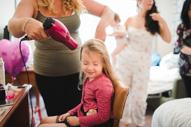 Little girl having her hair styled