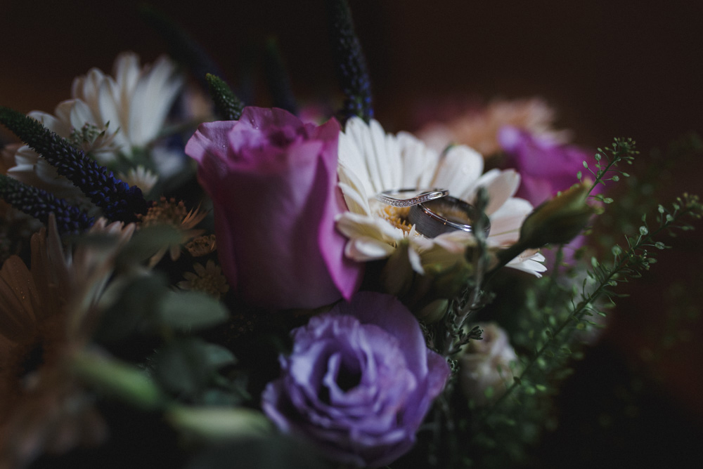 wedding rings in flowers, gwel an mor