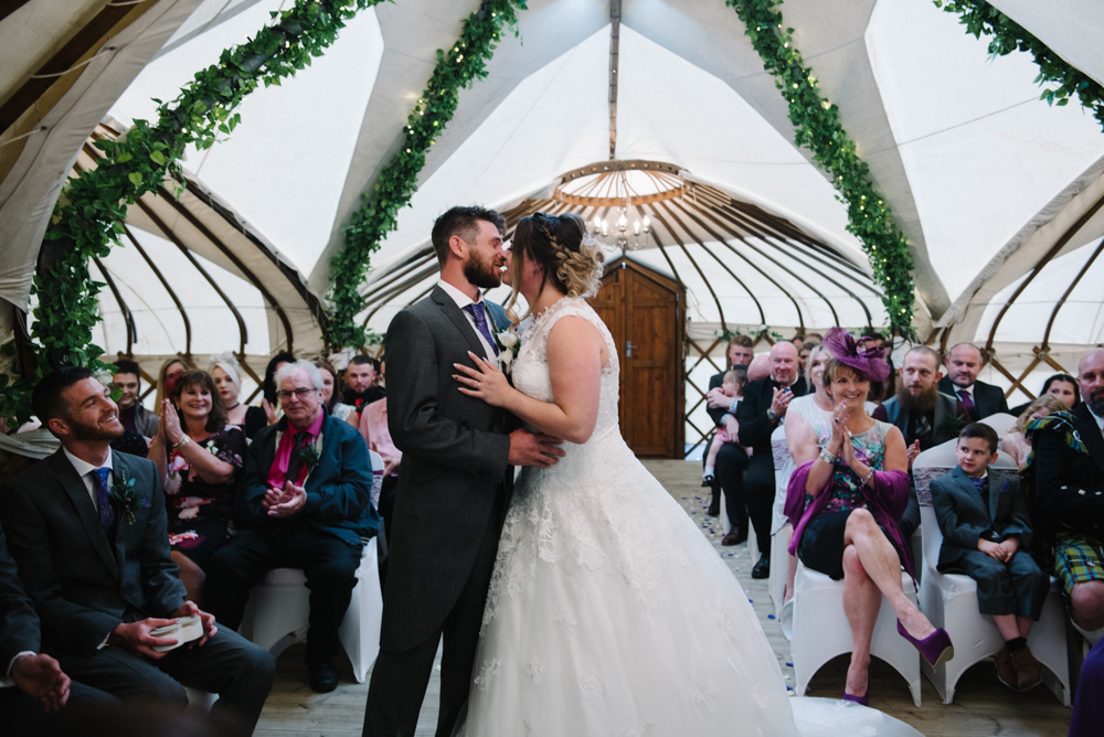 Bride and groom first kiss gwel an mor