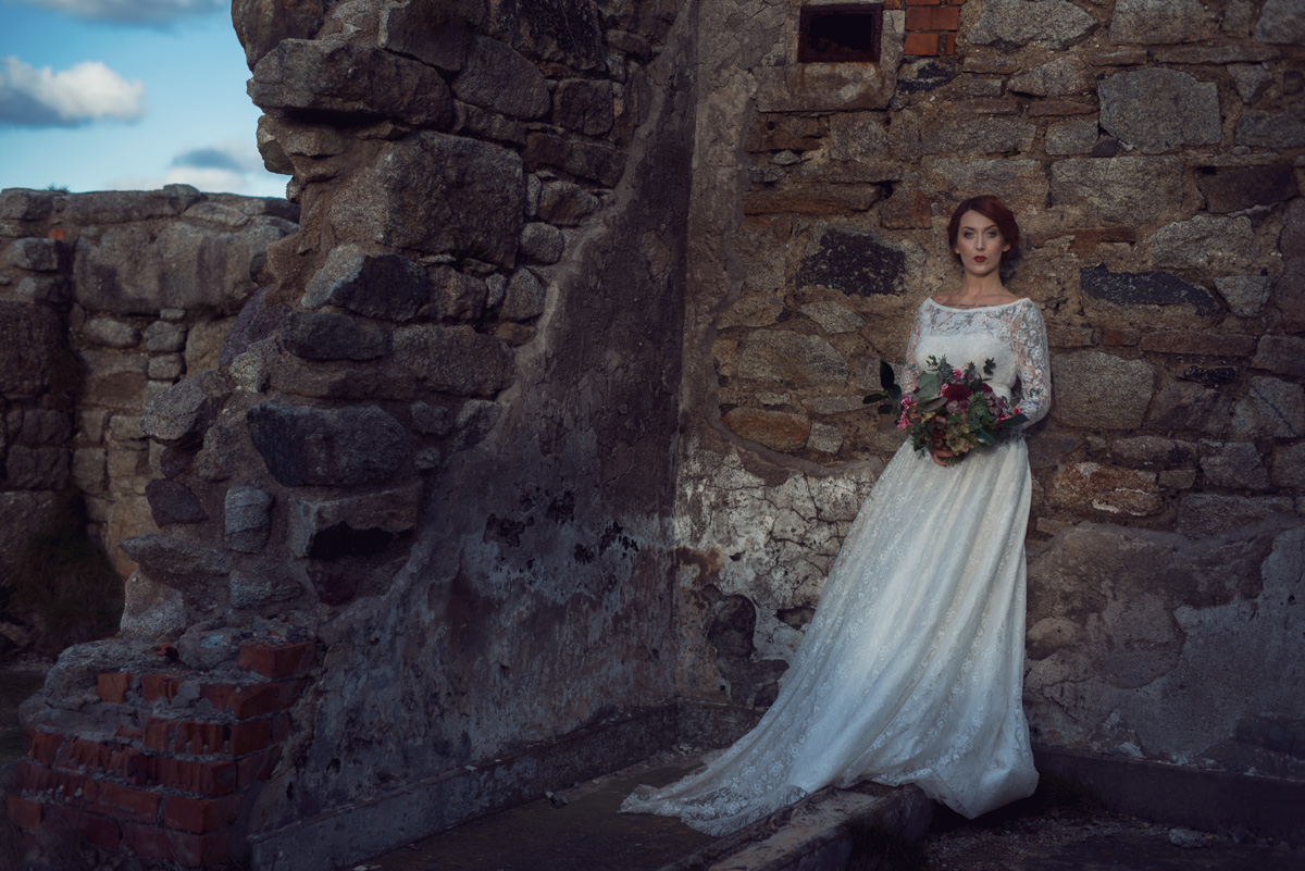 Bride stood in natural light