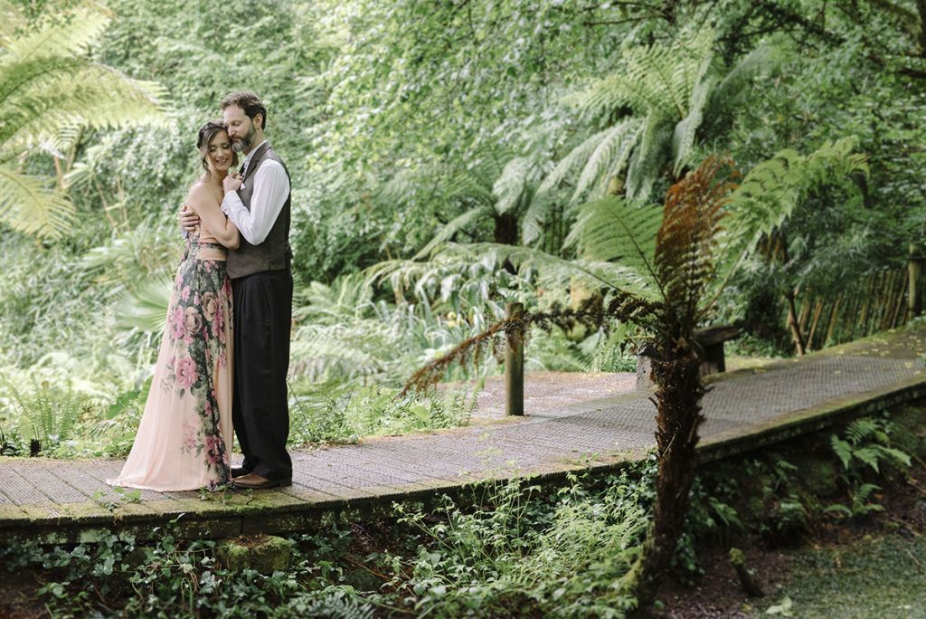 Bride and groom dancing in a tropical garden