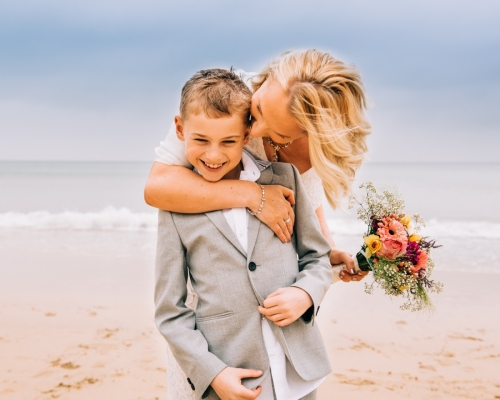 Mother and son on a beach wedding