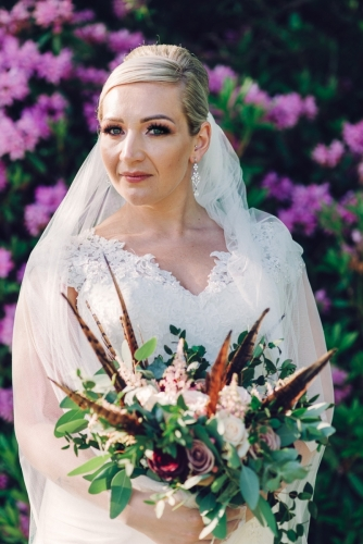 Bride in flowers Carlyon bay